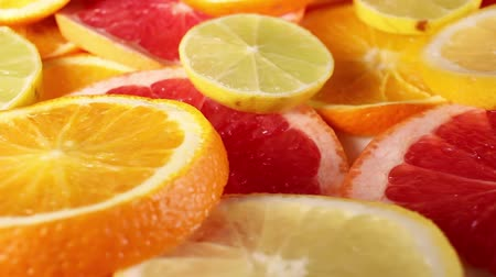 Grapefruits. Grapefruit slices rotating pattern macro texture background backdrop footage video.