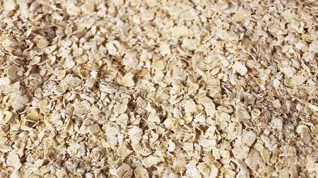 мини : Cereal grains rotating pattern macro texture background backdrop footage video.