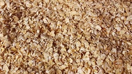Cereal grains rotating pattern macro texture background backdrop footage video.