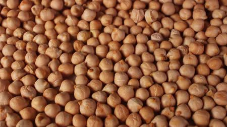 Chickpeas chickpea grains rotating pattern macro texture background backdrop footage video.