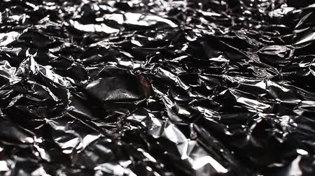 Aluminium foil rotating pattern macro texture background backdrop footage video.