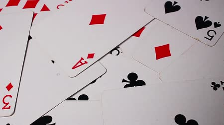 Playing cards. Poker card rotating pattern macro texture background backdrop footage video.