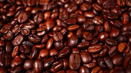 мини : Coffee beans grains whole coffees rotating pattern macro texture background backdrop footage video. Стоковые видеозаписи