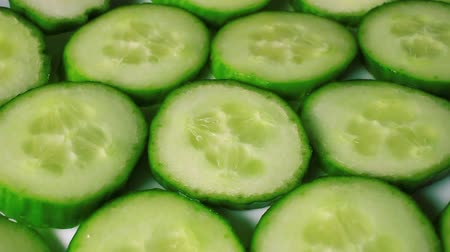 Cucumber slices rotating pattern macro texture background backdrop footage video.