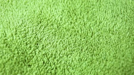 Green Carpet fabric rotating pattern macro texture background backdrop footage video.