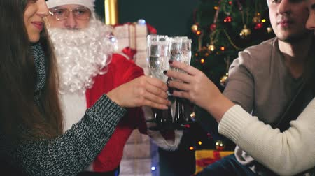 ded : Young couple with Santa celebrating New Year 2017, Christmas Stock Footage
