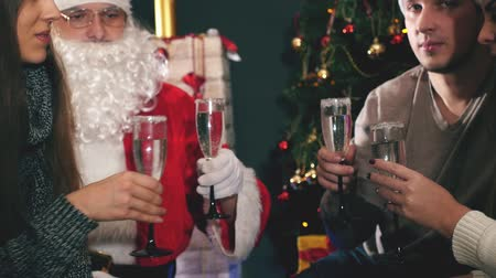 ded : Group of young people with Santa celebrating New Year 2017