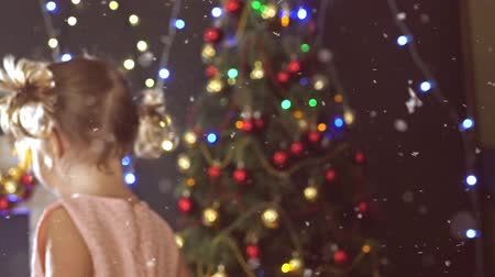Cute little girl dancing, background decorated Christmas tree Stock Footage