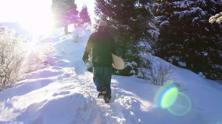 Footage of snowboarder man adventure, walking to snowy alps mountains
