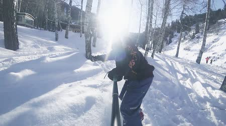 Slow motion footage of snowboarder man riding through the forest Stock Footage