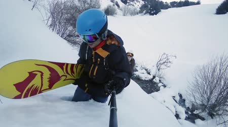 gidip : Footage of snowboarders man and girl adventure at mountain backcountry.
