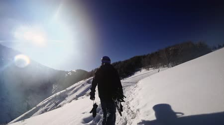 gidip : Footage of snowboarder man adventure, walking to snowy alps mountains