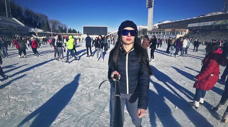 Full HD footage young woman ice skating outdoor at ice rink Medeo Stock Footage