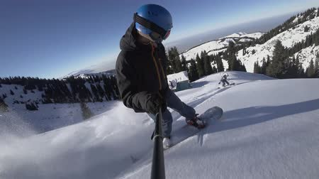 Close up of extreme snowboarder riding by powder by GoPro Stock Footage