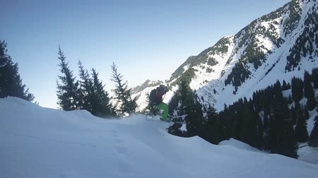 Aerial view footage skier riding by powder at mountain backcountry