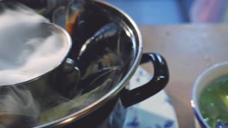 Mussels smoked cooked in restaurant at the table. Shellfish Stock Footage