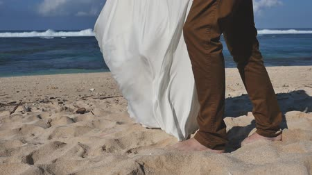 propor : Footage of Wedding couple just married and walking at beach