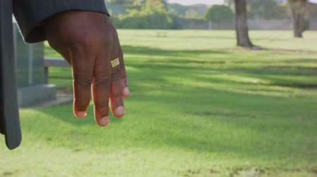 esküvő : African American Hand Wedding Ring Close Up in a park graveyard. Stock mozgókép