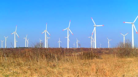 hatalom : Wind power generators on blue sky