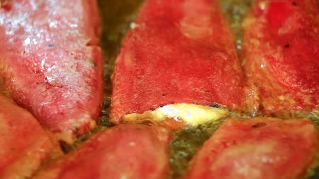 pimentas : Cooking delicious fried red peppers filled in with eggs and cheese closeup