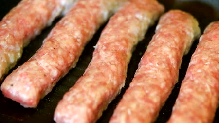 veal recipe : Baking fresh minced meat on barbecue closeup