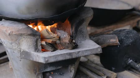 Food cooking on a traditional stove, Close up fire from burning firewood.