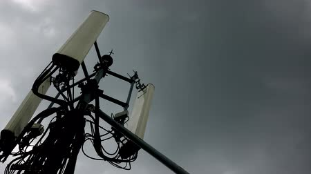 telecoms : Cellular towers and internet on the background of the sky are clouds of rain. Stock Footage
