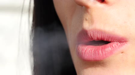papieros : close up of young woman smoking a cigarette Wideo