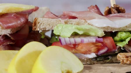 sandwiches with salad, tomatoes, ham and onions