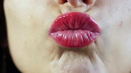 sending : young woman sending kiss, close up and slow motion