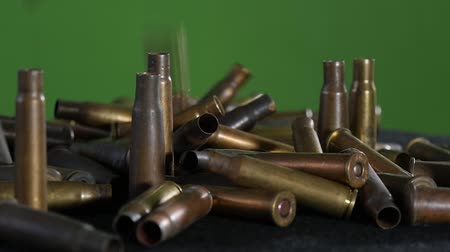 калибр : ammunition in front of a green screen