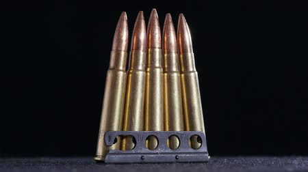 калибр : bullets ammo on a black table