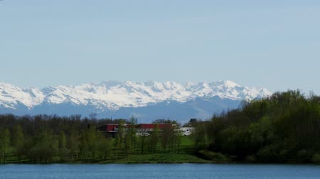 lake with Pyrenees mountains on background Stok Video