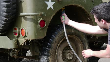 por que : young man cleaning the military