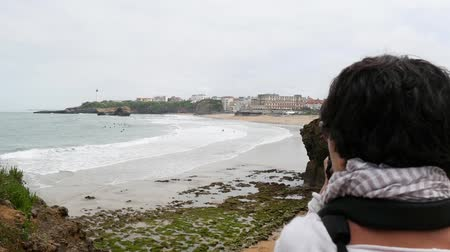 basque : woman photographer taking picture of Biarritz beach
