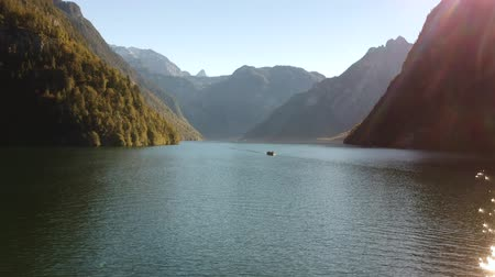 bajor : A boat floating down Koenigsee between the mountains in Bavaria, Germany.