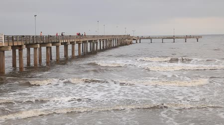 рыболовство : Fishing pier at the Gulf of Mexico coast in Galvestion Island. Texas, USA