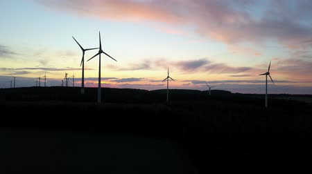 Wind turbines at sunset. Drone footage Стоковые видеозаписи