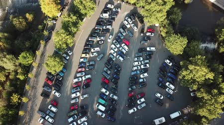 Drone shot of a parking lot in the city with lots of cars