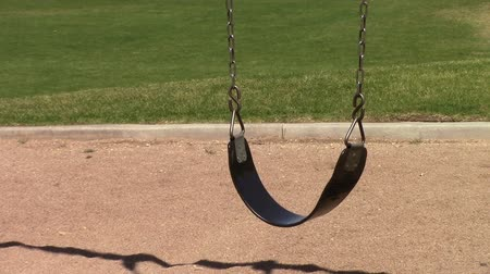 An empty swing  in a playground in Mesa, Arizona