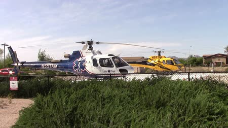Mesa, Arizona, USA - April 21 2015:  Two medi-vac emergency helicopters on standby in the hospital parking lot Taken April 21, 2015
