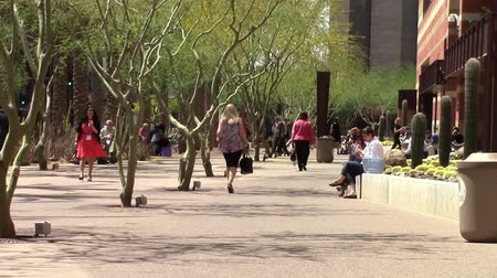 Phoenix, Arizona, USA - April 20, 2015: Employees relaxing while enjoying a lunch break at a corporate plaza.  Taken Apr 20, 2015