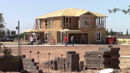 Mesa, Arizona, USA - April 20, 2015: Workers building new homes on the construction  job site. Taken April 20, 2015