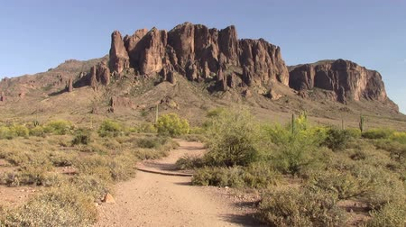 Superstition Mountains located in Lost Dutchman State Park in Apache Junction, Arizona. The park is famous for the legend of a gold mine somewhere in the park discovered by a German immigrant named Jacob Waltz back in 1891.