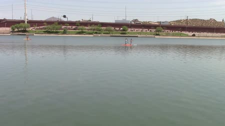 Tempe Town Lake, Arizona.  Paddle boarders floating down the lake.