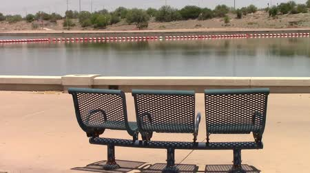 Tempe Town Lake, Arizona. Zoom in of three empty park benches on the south shore of the lake