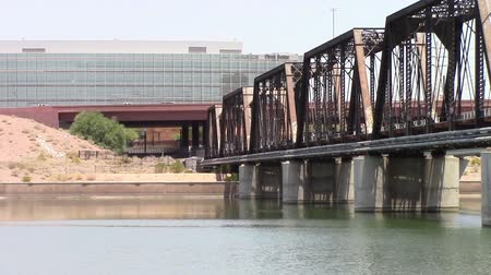 Tempe, Arizona, USA - June 24, 2015: Tempe Town Lake. Railroad bridge connects the north and south shores of the popular lake.