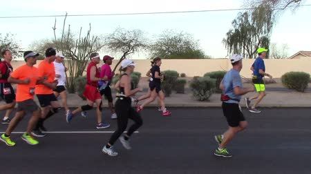Mesa, Arizona, USA - February 27, 2016: Runners from all over the US participated in the BMO Harris Bank MarathonSide view of runners participating in a marathon.