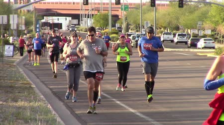 Mesa, Arizona, USA - February 27, 2016: Runners from all over the US participated in the BMO Harris Bank Marathon.Front view of runners participating in a marathon