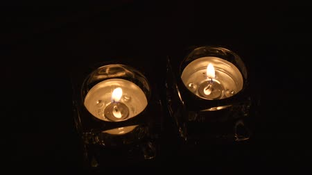 equinox : Wide shot two tealight holders in evening